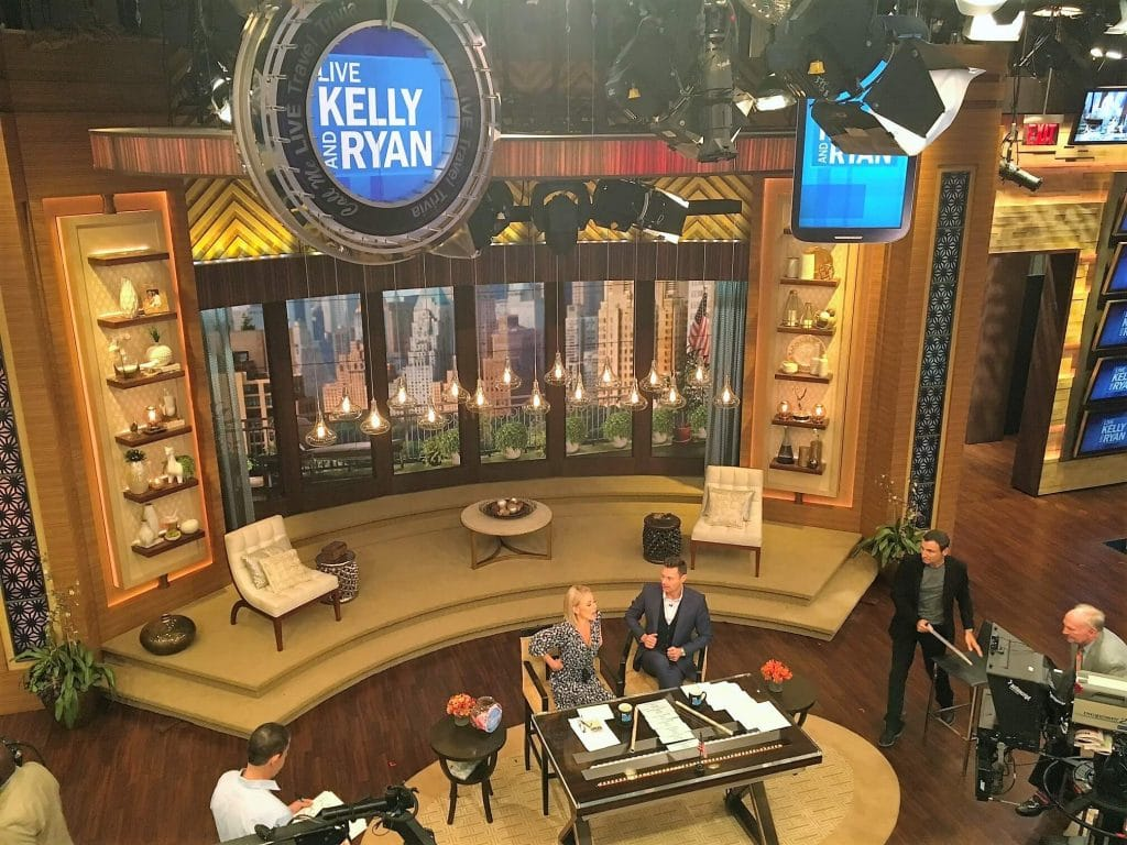 """The host chat at the beginning of the show. You can see Gelman off in the right side of the picture. - - """"How to See TV Tapings in NYC With 1iota Tickets"""" - Two Traveling Texans"""